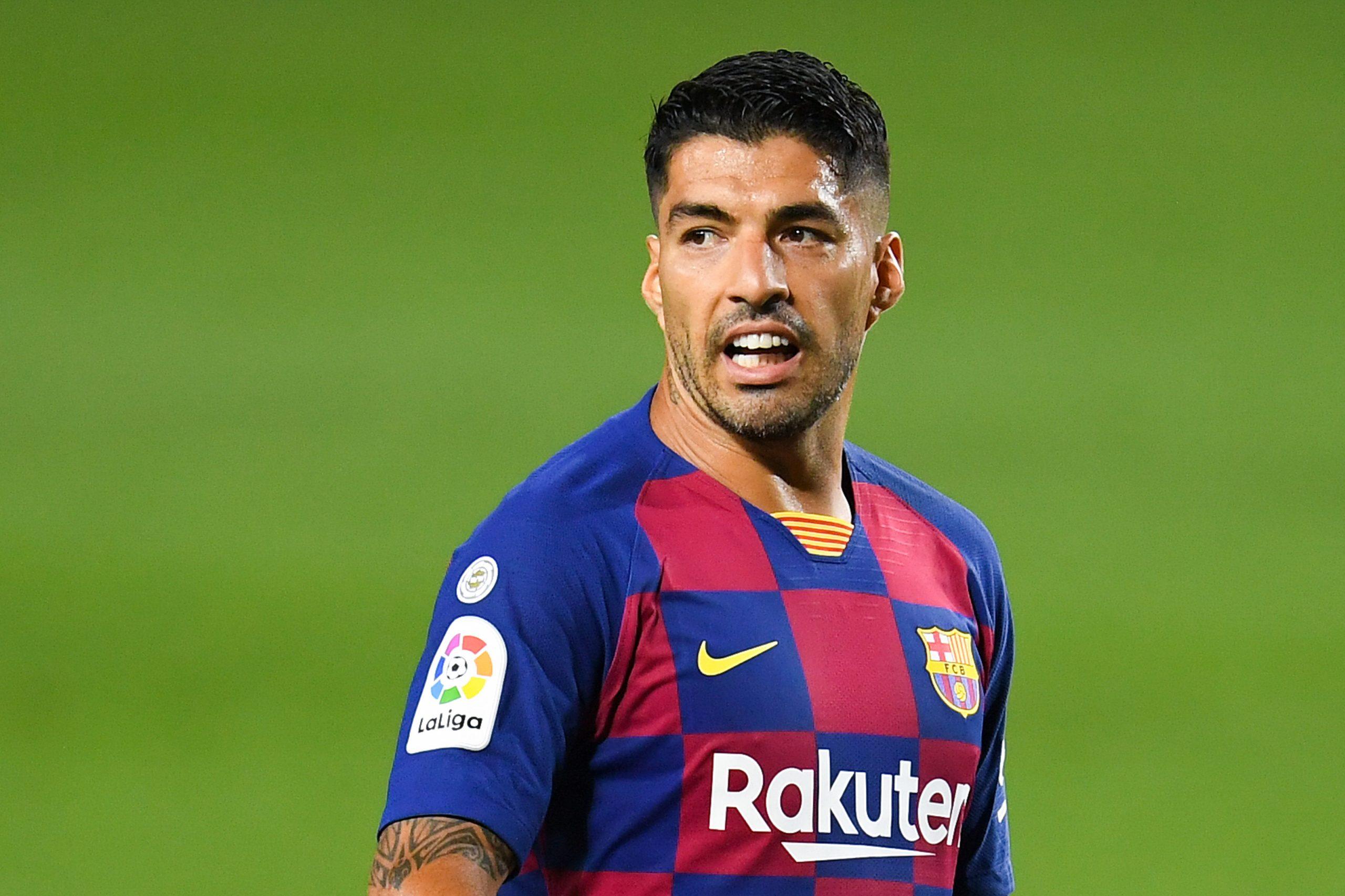 Suarez returns to Barcelona training