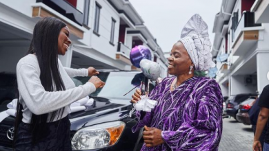 Photo of Tomike Adeoye, media personality gifts mother a vehicle