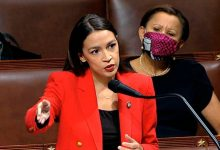 Photo of US Capitol protester charged with threatening to 'assassinate' AOC