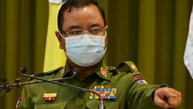 Photo of Myanmar army warns: 'You could be shot in the head and back'