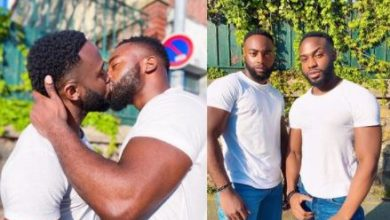 Photo of Bolu Okupe, gay son of ex-presidential intensely kisses partner